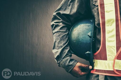 Man holding blue helmet close up